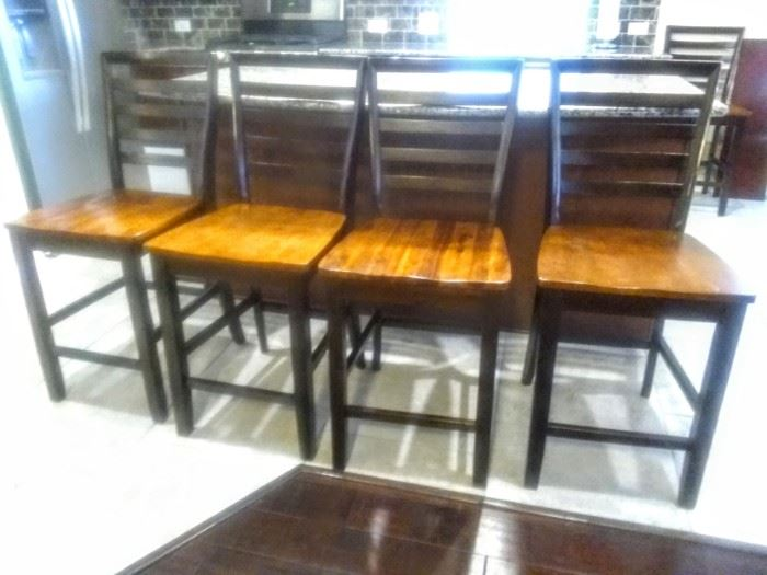 Four great Bar Stools plus one more in another area .