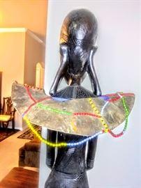 """Back view of """"Makonde"""" sculpture."""