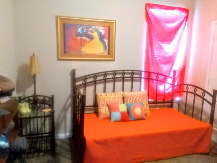 """Lovely colorful room with """"Day-Bed""""  pull-out /up bottom for a mattress and lamp table."""