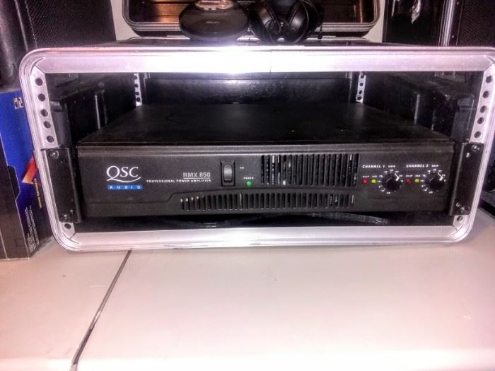 """""""QSC Audio"""" Equipment for speaker system."""