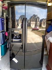 Beautiful black Double-Door Refrigerator with ice-maker.