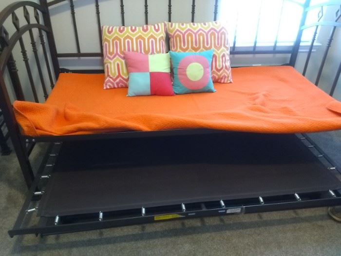 Day-Bed has bottom frame th pull-out then pull-up becomes Queen-Size bed.