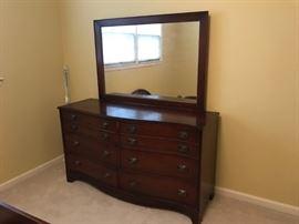 #41 Bassett Curved Front Dresser w/mirror  58x19x32  Mirror 47x33  $175.00