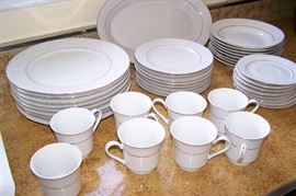 China Gold ring 40 total pieces, 8 piece place settings;  one chip on dessert plate and one broken cup handle