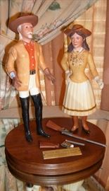 BUFFALO BILL AND ANNIE OAKLEY  COMMERATIVE PIECE -SLIGHT DAMAGE TO THE  GUNS