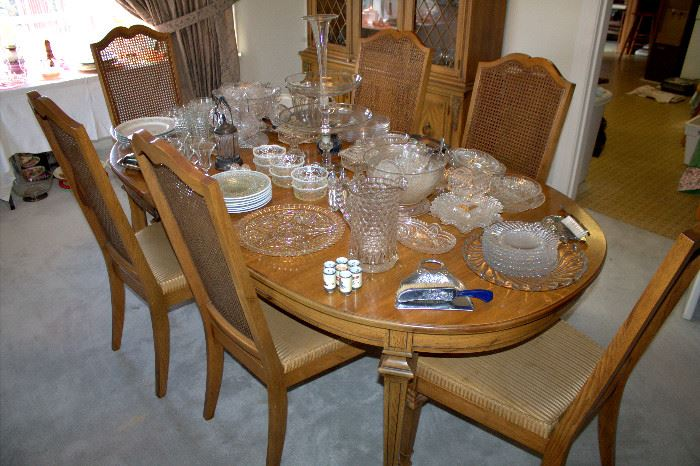 Dining table with 2 leaves, table pads, and 6 chairs
