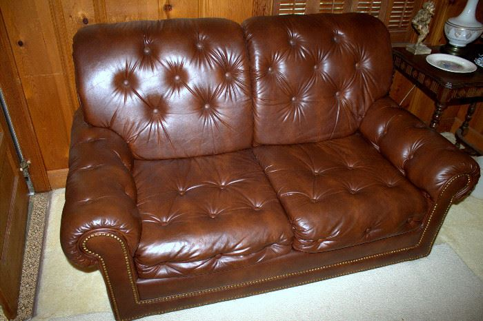 Brown vinyl loveseat
