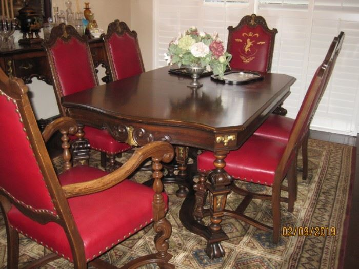 1930's Era Dining Table with Six (6) Chairs  Two Captains Chairs with Lion Crest on back and Four Side Chairs Available For Immediate Purchase  As a Set Asking $9,000 for All Pieces