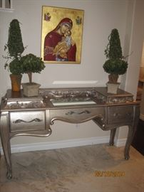 Pulaski Desk, Silver Finish with Mirrored Writing Surface, Framed Icon, Decorative Crystal Figurines and Decorative Greenery