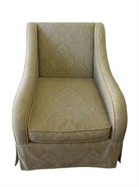 "Paisley Arm Chair. Beautifully upholstered in a soft, neutral woven cotton paisley in a sage green color scheme with gold accents. Gold silk single welt detail throughout. Corner pleated tailored dress skirt. Zippers on cushion covers for easy removal and cleaning. Seat and back cushion made of polyurethane foam and wrapped in a removable case with zipper of sterilized waterfowl down and feathers. This chair sits deep, but very comfortable with the down's giving characteristic.  A wonderful chair that has many years of enjoyment left! Dimensions: 30.5""w x 38.5""d x 36""h • Seat=19""h • Arm=23.5""h Condition: In perfect condition!"