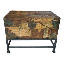 "Antique hand painted pig skin Chinese wedding trunk surmounting an iron. The stand (new) is done in a mottled green, black and subtle gold finish giving it a feeling of having an antique patina with a stretcher connecting all legs and square bevelled feet. The scene depict courtesans in the royal palace in the Spring or Summer indicated by the cherry blossoms. Original engraved round brass latch on front and handles on either side. Interior is lined in a blue silk with exposed stitching. A beautiful piece at the end of a bed or for use as a coffee or accent table! W= 31"" x20""D X 24"" H"