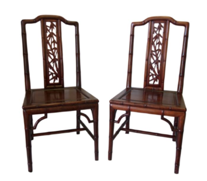 """Pair of Chinese Huanghuali Detailed Chairs            Details: A set of two matching huanghuali wood chairs. Made out of prized Chinese Huanghuali wood (Golden Phoebe) and beautifully carved and shaped to mimics stalks of bamboo. Back of chair features a carved panel of carved bamboo. Dimensions: 17.75""""w x 16.5""""d x 37""""h • Seat=17""""h (16lbs each)  Condition: One of the chairs has a scratch on the seat that can be easily covered with a cushion. Slight paint scuff on one leg that can be removed carefully. One chair is slightly darker than the other."""