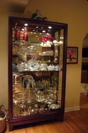 "Chocolate Curio Cabinet with sliding door.                                     Dimensions: 46""l x 15""d  x 83""h (281lbs)"
