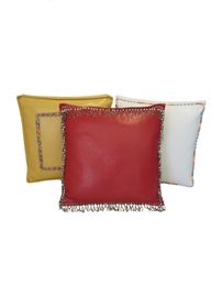 "Trio of Leatherette Boxed Decorative Pillows Details: Custom made set of three Boxed square cushions or shams with flanged edges, cording and decorative trim. The set includes one chili pepper red vinyl pillow with a beaded pearl trim, one honey mustard yellow vinyl pillow with a picture frame border in floral ribbon trim and one brilliant white vinyl cushion with a Scalamandre plaid piping. Each cushion has a zipper for easy removal and cleaning.  20"" feather down inserts included which make them plump and firm.  Dimensions: 20""x  4""d x 20""h (each pillow)"