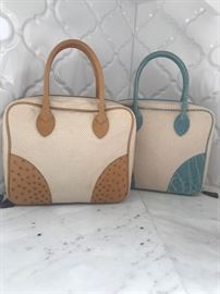 Lana Marks bags, cream canvas base with Almond ostrich corner tabs and handle (left) and Cream canvas with sky colored Alligator corner tabs and handle (right). Very Chic!