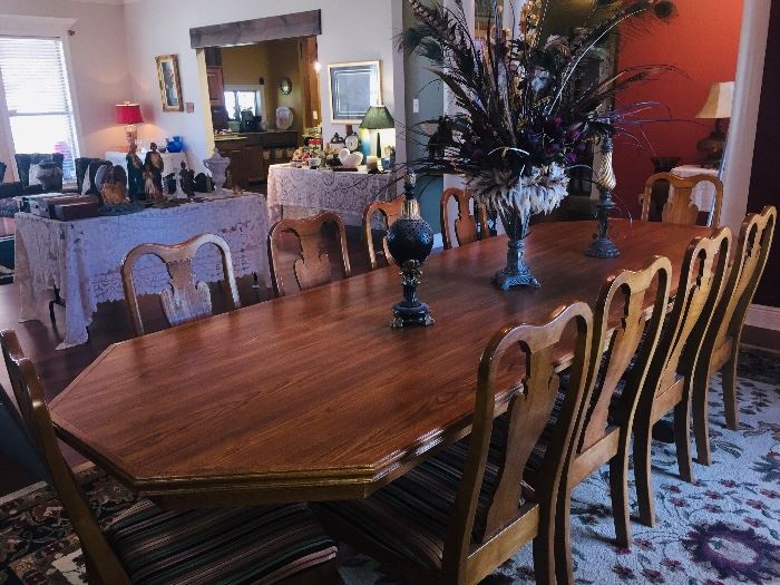 beautiful dining table with seating for 10.  Custom made table features a top made of one solid piece of Oak