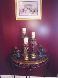 many pieces of decorator furniture and accents