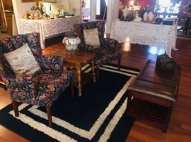 chairs, rugs, end tables, leather bench