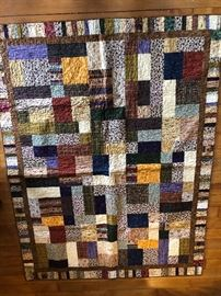 Another view of the gorgeous quilt. Hand pieced.