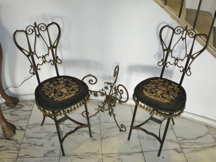Lovely Pair of Victorian Wrought Iron, Embroidered Seat Cafe Chairs; Hollywood Regency Foliate Table Base.