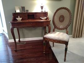 Italian inlaid walnut ladies writing desk together with an Italian painted cane back side chair