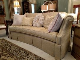 Beautiful curved sofa with custom made pillows