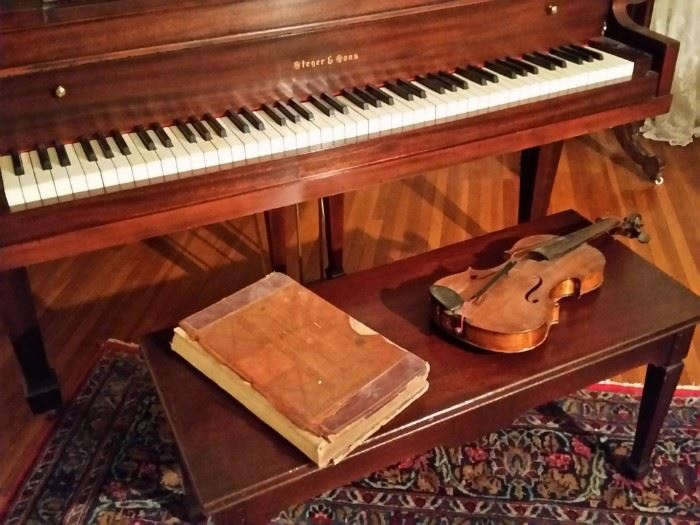 Ledger from 1901 and one of two violins.  This violin has an Antonius Stradivarius Cremonensis label inside.