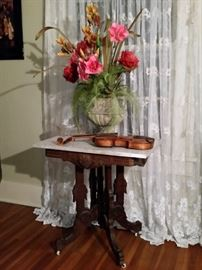 Marble top Victorian table and violin  that has a 'Guarneri' label inside.
