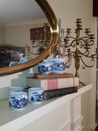 Some of the fine porcelain pieces and a brass candelabra