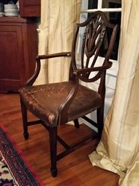 Eight antique mahogany mid 1800's English Hepplewhite shield-back with Prince of Wales feather motif design. Two armchairs,  six side chairs, original leather seats.