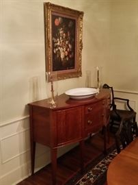 Oil painting of roses and a beautiful cherry sideboard built by a Nashville furniture maker