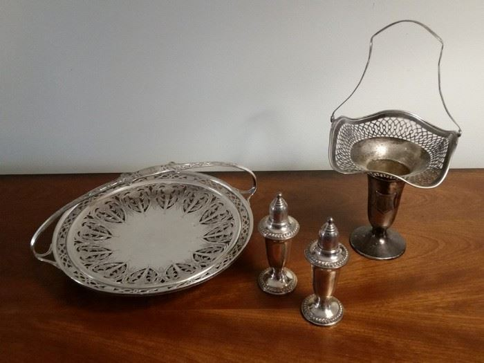 A pair of sterling silver salt/pepper shakers and two other sterling silver pieces.   All items made of precious metals are stored in a safe off site until the days of the sale.