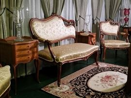 Pair of 3-drawer French nightstands/end tables.  A Rococo Revival parlor set that includes this settee, two armchairs, and two side chairs.