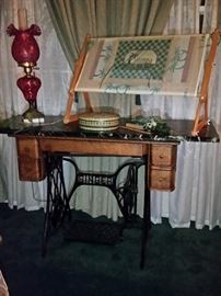 Old Singer sewing machine cabinet repurposed as a marble top table