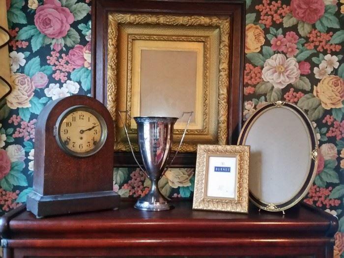 On the left is an antique Seth Thomas shelf clock