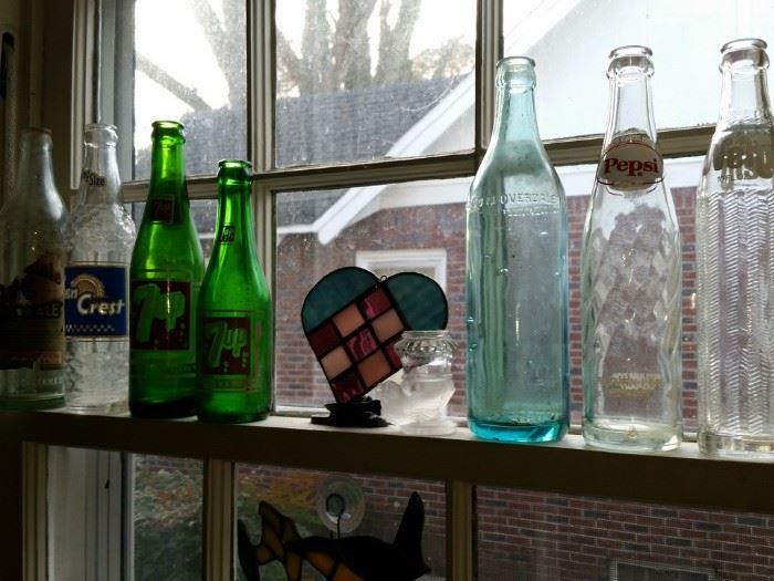 Some of many soda bottles