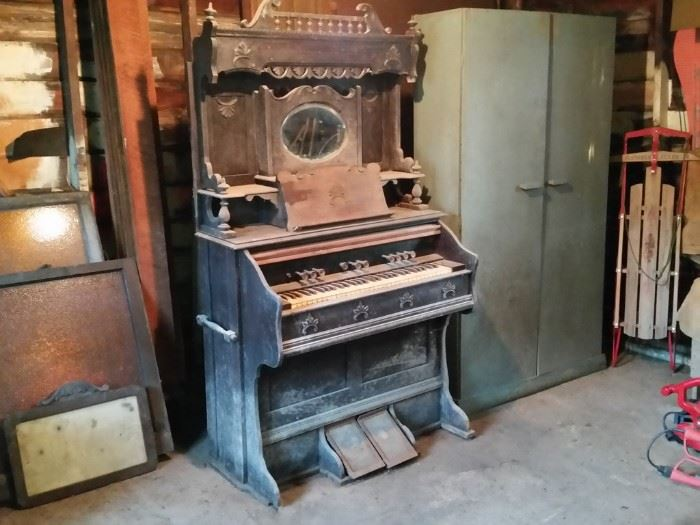 This antique pump organ was to be a restoration project.    It's old and dusty, but it still works.