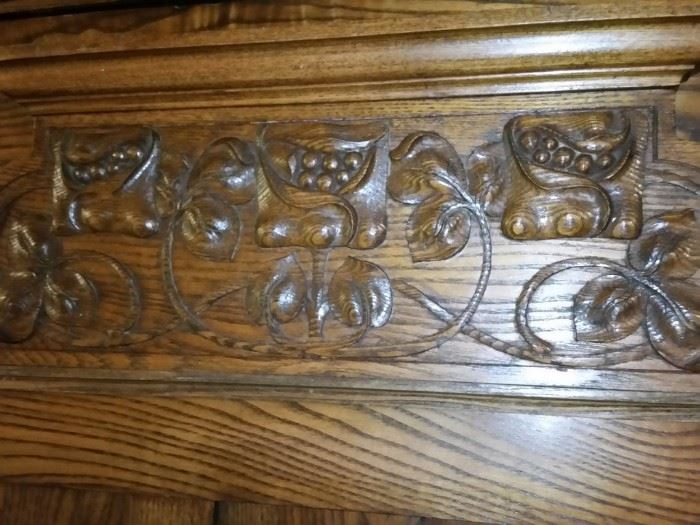 A closer look at the woodwork of the antique wardrobe