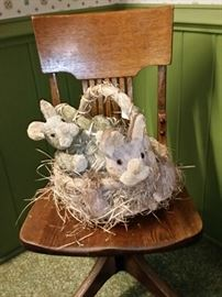 Two more Easter bunnies on an antique oak bankers swivel chair