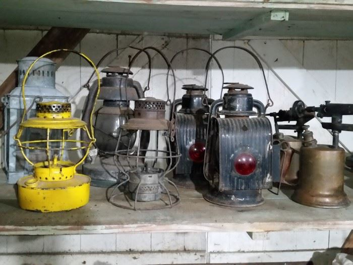 Nautical oil lantern, railroad lanterns, pair of Dietz buggy lanterns, and blow torches