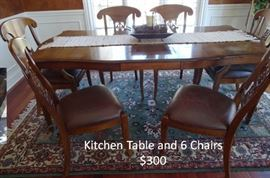 Kitchen Table six chairs with extra leaf