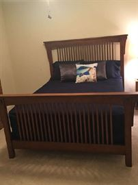 Queen Size Wood Bed; can be sold with or without mattress.  Décor not included