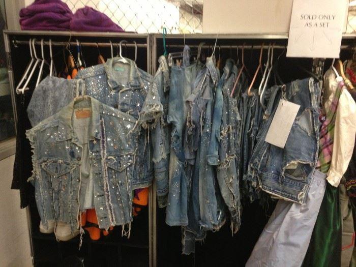 One Lot Mens and Womens Swarovski Rhinestone Cowboy Denim Pants Skirts Tops Hats. 8 pairs of jeans, 3 jeans skirts, 6 jeans jackets, two tank tops and eight hats.