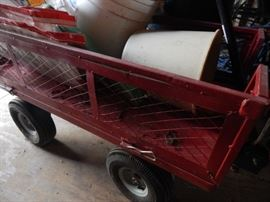 Great cart on wheels.  Move all your gardening items around the yard.