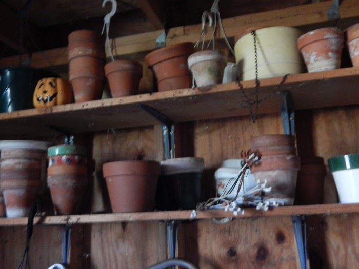 Lots of clay pots and other gardening tools.