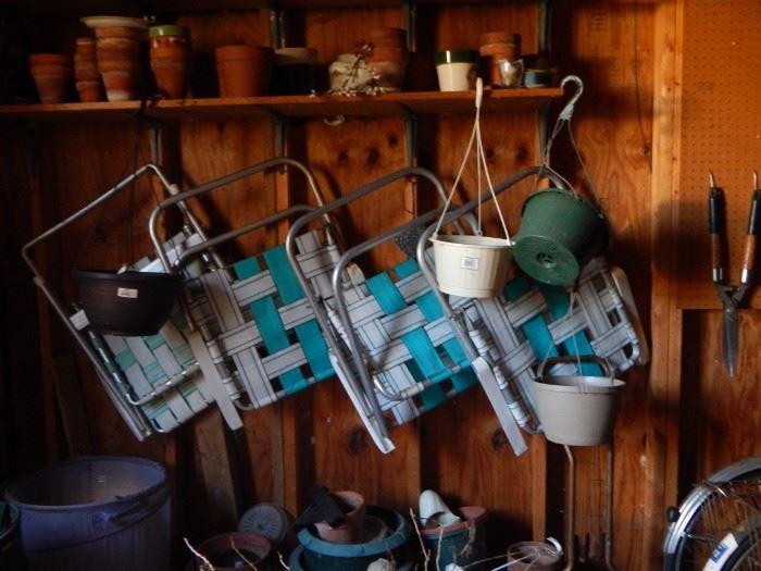 Folding chairs , garden tools , clay pots.