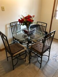 Kitchen Table with 4 chairs; brown seat seats.