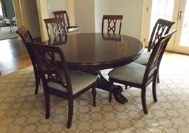 "Stanley 64""-82"" Expandable Round Dining Room Table Set 10 Chairs. The leaves go around the table as seen in the next picture."