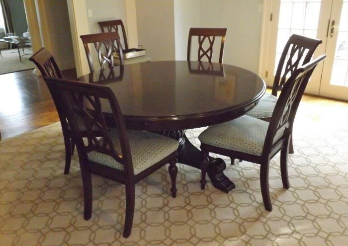 """Stanley 64""""-82"""" Expandable Round Dining Room Table Set 10 Chairs. The leaves go around the table as seen in the next picture."""