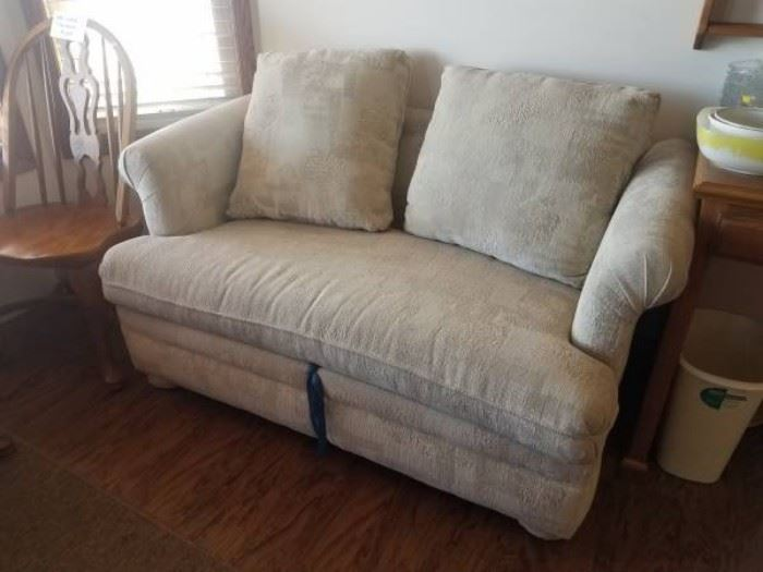 Two-person white love seat